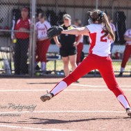 Hoisington Lady Cardinal Taylor Boxberger (#24) throws a pitch in the top of the first inning. The Hoisington Lady Cardinals defeated the Halstead Lady Dragons by a score of 12 to 2 in six innings at Logan Field in Hoisington, Kansas on April 27, 2018. (Photo: Joey Bahr, www.joeybahr.com)