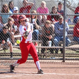 Hoisington Lady Cardinal Bailee Bachar (#8) swings at a pitch in the bottom of the first inning. The Hoisington Lady Cardinals defeated the Halstead Lady Dragons by a score of 12 to 2 in six innings at Logan Field in Hoisington, Kansas on April 27, 2018. (Photo: Joey Bahr, www.joeybahr.com)