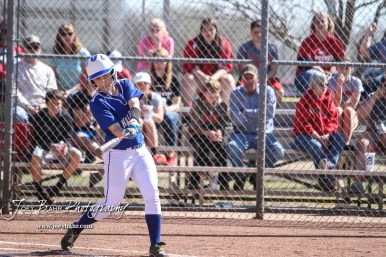 Halstead Lady Dragon Bailey Goodman (#13) swings at a pitch in the top of the second inning. The Hoisington Lady Cardinals defeated the Halstead Lady Dragons by a score of 12 to 2 in six innings at Logan Field in Hoisington, Kansas on April 27, 2018. (Photo: Joey Bahr, www.joeybahr.com)
