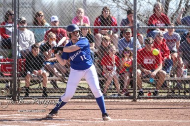 Halstead Lady Dragon Solle-Ann Werner (#11) watches a pitch coming towards her in the top of the second inning. The Hoisington Lady Cardinals defeated the Halstead Lady Dragons by a score of 12 to 2 in six innings at Logan Field in Hoisington, Kansas on April 27, 2018. (Photo: Joey Bahr, www.joeybahr.com)