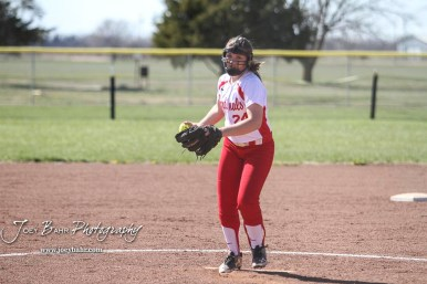 Hoisington Lady Cardinal Taylor Boxberger (#24) winds up to deliver a pitch in the top of the third inning. The Hoisington Lady Cardinals defeated the Halstead Lady Dragons by a score of 12 to 2 in six innings at Logan Field in Hoisington, Kansas on April 27, 2018. (Photo: Joey Bahr, www.joeybahr.com)