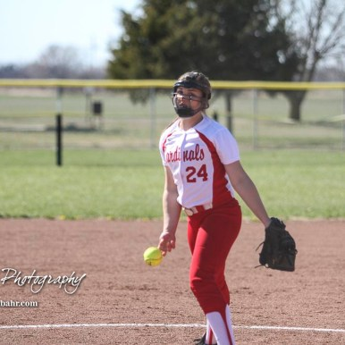 Hoisington Lady Cardinal Taylor Boxberger (#24) delivers a pitch in the top of the third inning. The Hoisington Lady Cardinals defeated the Halstead Lady Dragons by a score of 12 to 2 in six innings at Logan Field in Hoisington, Kansas on April 27, 2018. (Photo: Joey Bahr, www.joeybahr.com)