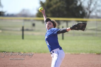 Halstead Lady Dragon Callie Considine (#0) winds up to throw a pitch in the bottom of the third inning. The Hoisington Lady Cardinals defeated the Halstead Lady Dragons by a score of 12 to 2 in six innings at Logan Field in Hoisington, Kansas on April 27, 2018. (Photo: Joey Bahr, www.joeybahr.com)