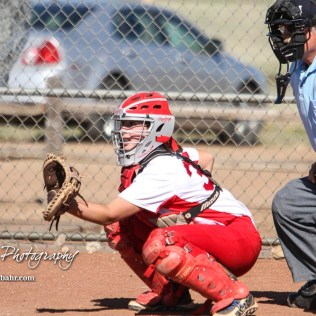 Hoisington Lady Cardinal Trinity Dolezal (#33) watches for a pitch to cross the plate in the top of the fifth inning. The Hoisington Lady Cardinals defeated the Halstead Lady Dragons by a score of 12 to 2 in six innings at Logan Field in Hoisington, Kansas on April 27, 2018. (Photo: Joey Bahr, www.joeybahr.com)