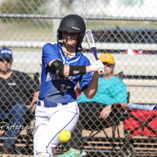 Halstead Lady Dragon Starr Barrett (#12) watches a pitch come in low in the top of the fifth inning. The Hoisington Lady Cardinals defeated the Halstead Lady Dragons by a score of 12 to 2 in six innings at Logan Field in Hoisington, Kansas on April 27, 2018. (Photo: Joey Bahr, www.joeybahr.com)