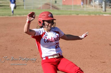 Hoisington Lady Cardinal Jenna Urban (#27) slides into third base to complete a lead off triple in the bottom of the fifth inning. The Hoisington Lady Cardinals defeated the Halstead Lady Dragons by a score of 12 to 2 in six innings at Logan Field in Hoisington, Kansas on April 27, 2018. (Photo: Joey Bahr, www.joeybahr.com)