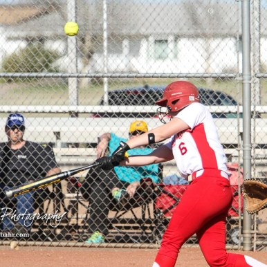 Hoisington Lady Cardinal Brooke Reif (#6) pops up a ball that goes foul in the bottom of the sixth inning. The Hoisington Lady Cardinals defeated the Halstead Lady Dragons by a score of 12 to 2 in six innings at Logan Field in Hoisington, Kansas on April 27, 2018. (Photo: Joey Bahr, www.joeybahr.com)