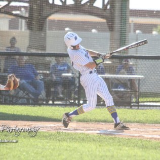 Bluestem Lion #11 Hunter Clift swings at a pitch in the top of the first inning. The Spearville Royal Lancers defeated the Bluestem Lions 5 to 1 in the KSHSAA Class 2-1A State Baseball Quarterfinal at the Great Bend Sports Complex in Great Bend, Kansas on May 24, 2018. (Photo: Joey Bahr, www.joeybahr.com)