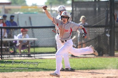 Chase County Bulldog #13 Blaise Holloway celebrates adding another run to the score in the top of the fifth inning. The Chase County Bulldogs defeated the West Elk Patriots 16 to 5 in the KSHSAA Class 2-1A State Baseball Quarterfinal at the Great Bend Sports Complex in Great Bend, Kansas on May 24, 2018. (Photo: Joey Bahr, www.joeybahr.com)