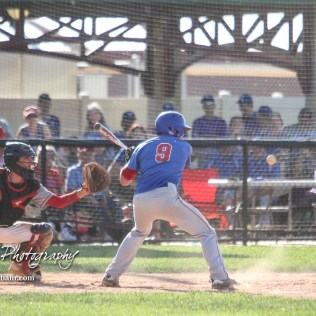 West Elk Patriot #9 Mason Harrod starts to swing at an approaching pitch in the bottom of the fifth inning. The Chase County Bulldogs defeated the West Elk Patriots 16 to 5 in the KSHSAA Class 2-1A State Baseball Quarterfinal at the Great Bend Sports Complex in Great Bend, Kansas on May 24, 2018. (Photo: Joey Bahr, www.joeybahr.com)