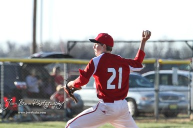 Hoisington Cardinal Isaac Prosser (#21) throws a pitch in the top of the first inning. The Hoisington Cardinals defeated the Halstead Dragons by a score of 10 to 6 at Legion Field in Hoisington, Kansas on April 27, 2018. (Photo: Joey Bahr, www.joeybahr.com)