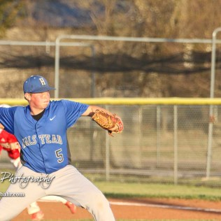 Halstead Dragon Carson Considine (#5) throws a pitch in the bottom of the third inning. The Hoisington Cardinals defeated the Halstead Dragons by a score of 10 to 6 at Legion Field in Hoisington, Kansas on April 27, 2018. (Photo: Joey Bahr, www.joeybahr.com)