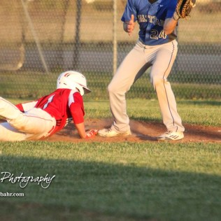 Hoisington Cardinal Trey Byers (#1) gets back to first base in the bottom of the fourth inning. The Hoisington Cardinals defeated the Halstead Dragons by a score of 10 to 6 at Legion Field in Hoisington, Kansas on April 27, 2018. (Photo: Joey Bahr, www.joeybahr.com)
