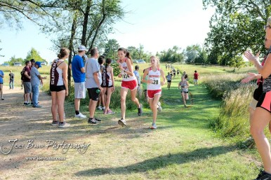 McPherson's Emma Mohl (#434) and Natalie Hedlund (#428) pass by spectators on the course. The Great Bend Cross Country Invitational was held at Lake Barton near Great Bend, Kansas on August 30, 2018. (Photo: Joey Bahr, www.joeybahr.com)