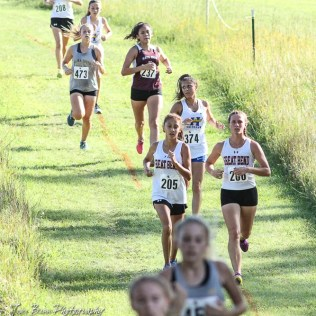 Runners make their way down a hillside on the course. The Great Bend Cross Country Invitational was held at Lake Barton near Great Bend, Kansas on August 30, 2018. (Photo: Joey Bahr, www.joeybahr.com)