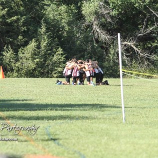 The Hays boys varsity Cross Country team huddles before the start of their race. The Great Bend Cross Country Invitational was held at Lake Barton near Great Bend, Kansas on August 30, 2018. (Photo: Joey Bahr, www.joeybahr.com)