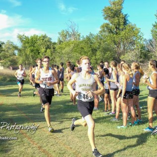 Keetan Munsell (#484) leads a pack of runners near the crest of the first hill. The Great Bend Cross Country Invitational was held at Lake Barton near Great Bend, Kansas on August 30, 2018. (Photo: Joey Bahr, www.joeybahr.com)