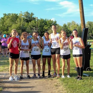 The Great Bend girls varsity teams pose with their first place medals. The Great Bend Cross Country Invitational was held at Lake Barton near Great Bend, Kansas on August 30, 2018. (Photo: Joey Bahr, www.joeybahr.com)