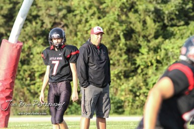 Little River Redskin Head Coach Chad Lafferty looks at a player running a route during warmups. The Central Plains Oilers defeated the Little River Redskins by a score of 46 to 0 at Community Memorial Park in Little River, Kansas on September 21, 2018. (Photo: Joey Bahr, www.joeybahr.com)