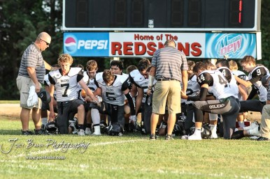 The Central Plains Oilers kneel for a team prayer prior to the start of the game. The Central Plains Oilers defeated the Little River Redskins by a score of 46 to 0 at Community Memorial Park in Little River, Kansas on September 21, 2018. (Photo: Joey Bahr, www.joeybahr.com)