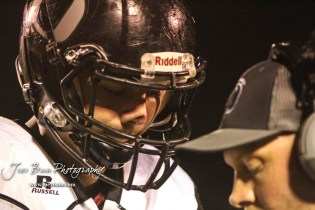 Central Plains Oiler #4 Myles Menges listens to his coach for the next play in the third quarter. The Central Plains Oilers defeated the Little River Redskins by a score of 46 to 0 at Community Memorial Park in Little River, Kansas on September 21, 2018. (Photo: Joey Bahr, www.joeybahr.com)