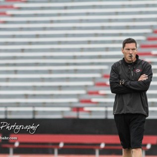 Great Bend Panther Head Coach Erin Beck walks towards where his players are warming up before the start of the game. The Hays Indians faced off with the Great Bend Panthers at Memorial Stadium in Great Bend, Kansas on September 7, 2018. (Photo: Joey Bahr, www.joeybahr.com)