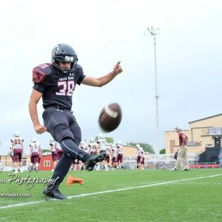Great Bend Panther #38 Dani Franco kicks off a ball during warmups prior to the start of the game. The Great Bend Panthers defeated the Hays Indians with a score of 15 to 7 at Memorial Stadium in Great Bend, Kansas on September 7, 2018. (Photo: Joey Bahr, www.joeybahr.com)