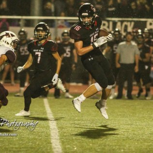 Great Bend Panther #16 Dalton Miller spins around Hays Indian #3 Taivian Creamer in the third quarter. The Great Bend Panthers defeated the Hays Indians with a score of 15 to 7 at Memorial Stadium in Great Bend, Kansas on September 7, 2018. (Photo: Joey Bahr, www.joeybahr.com)