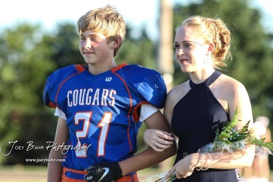 Freshman attendants Dalton Regan and Jode McCallie stand during Homecoming festivities. The Stafford Trojans faced the Otis-Bison Cougars at Cougar Field in Otis, Kansas on September 14, 2018. (Photo: Joey Bahr, www.joeybahr.com)