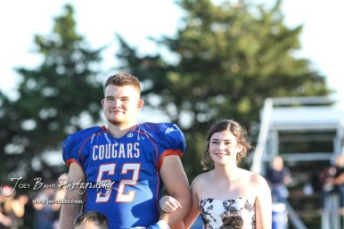 Homecoming King and Queen candidates Lucas Higgason and Hannah Tanger stand during Homecoming festivities. The Stafford Trojans faced the Otis-Bison Cougars at Cougar Field in Otis, Kansas on September 14, 2018. (Photo: Joey Bahr, www.joeybahr.com)