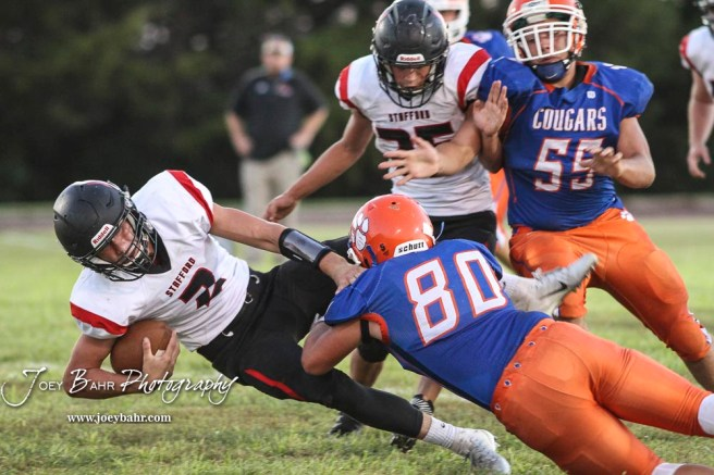Otis-Bison Cougar #80 Seth Hoopingarner tackles Stafford Trojan #2 Justice Manning in the first quarter. The Stafford Trojans faced the Otis-Bison Cougars at Cougar Field in Otis, Kansas on September 14, 2018. (Photo: Joey Bahr, www.joeybahr.com)