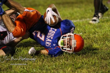Otis-Bison Cougar #2 Caleb Cheely falls to the ground after being tackled by Stafford Trojan #4 Ethan Hildebrand. The Stafford Trojans faced the Otis-Bison Cougars at Cougar Field in Otis, Kansas on September 14, 2018. (Photo: Joey Bahr, www.joeybahr.com)