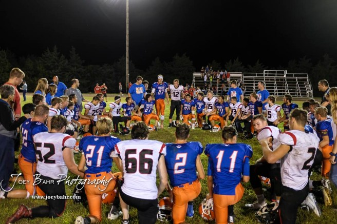 Both teams came together for a prayer after the game. The Otis-Bison Cougars defeated the Stafford Trojans by a score of 50 to 0 at Cougar Field in Otis, Kansas on September 14, 2018. (Photo: Joey Bahr, www.joeybahr.com)