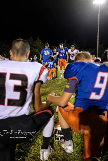 Members of the Otis-Bison Cougars and Stafford Trojans join together for a post game prayer. The Otis-Bison Cougars defeated the Stafford Trojans by a score of 50 to 0 at Cougar Field in Otis, Kansas on September 14, 2018. (Photo: Joey Bahr, www.joeybahr.com)