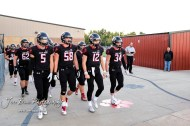 Senior members of the Great Bend Panthers lead their teammates onto the field. The Garden City Buffaloes traveled to face the Great Bend Panthers at Memorial Stadium in Great Bend, Kansas on October 19, 2018. (Photo: Joey Bahr, www.joeybahr.com)