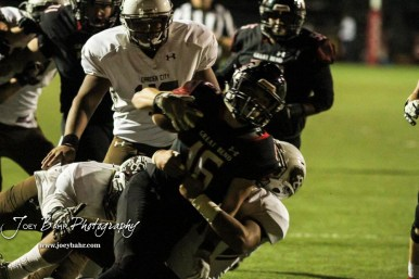 Great Bend Panther #16 Dalton Miller reaches out for more yards as he is tackled. The Great Bend Panthers defeated the Garden City Buffaloes 49 to 6 at Memorial Stadium in Great Bend, Kansas on October 19, 2018. (Photo: Joey Bahr, www.joeybahr.com)