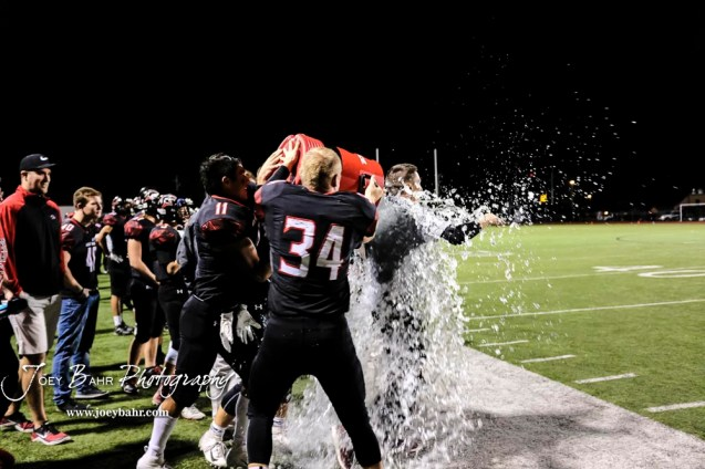 Great Bend seniors douse Head Coach Erin Beck with water to celebrate winning the Western Athletic Conference title outright for the first time in ten years. The Great Bend Panthers defeated the Garden City Buffaloes 49 to 6 at Memorial Stadium in Great Bend, Kansas on October 19, 2018. (Photo: Joey Bahr, www.joeybahr.com)