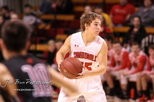 Hoisington Cardinal #25 Braxton Donovan looks for a teammate to pass the ball to in the first quarter. The Hoisington Cardinals defeated the Plainville Cardinals by a score of 70 to 53 at the Hoisington Activity Center in Hoisington, Kansas on February 5, 2019. (Photo: Joey Bahr, www.joeybahr.com)