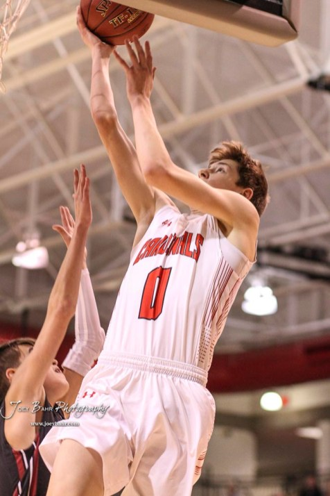 Hoisington Cardinal #0 Drew Nicholson goes for a layup in the first quarter. The Hoisington Cardinals defeated the Plainville Cardinals by a score of 70 to 53 at the Hoisington Activity Center in Hoisington, Kansas on February 5, 2019. (Photo: Joey Bahr, www.joeybahr.com)