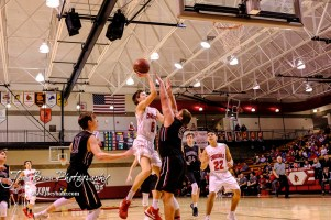 Plainville Cardinal #5 Jared Casey tries to keep Hoisington Cardinal #0 Drew Nicholson from shooting a layup in the first quarter. The Hoisington Cardinals defeated the Plainville Cardinals by a score of 70 to 53 at the Hoisington Activity Center in Hoisington, Kansas on February 5, 2019. (Photo: Joey Bahr, www.joeybahr.com)