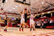 Hoisington Cardinal #15 Braden Mooney tries to block a shot by Plainville Cardinal #5 Jared Casey in the second quarter. The Hoisington Cardinals defeated the Plainville Cardinals by a score of 70 to 53 at the Hoisington Activity Center in Hoisington, Kansas on February 5, 2019. (Photo: Joey Bahr, www.joeybahr.com)