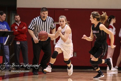Hoisington Lady Cardinal #21 Suzanna Schneider drives down the court as Plainville Lady Cardinal #3 Aubree Dewey pursues in the first quarter. The Plainville Lady Cardinals defeated the Hoisington Lady Cardinals by a score of 49 to 35 at the Hoisington Activity Center in Hoisington, Kansas on February 5, 2019. (Photo: Joey Bahr, www.joeybahr.com)