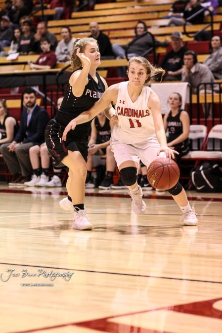 Hoisington Lady Cardinal #11 Keeley Wolf drives the baseline in the first quarter. The Plainville Lady Cardinals defeated the Hoisington Lady Cardinals by a score of 49 to 35 at the Hoisington Activity Center in Hoisington, Kansas on February 5, 2019. (Photo: Joey Bahr, www.joeybahr.com)