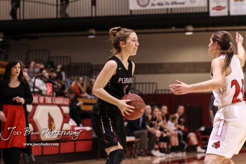 Plainville Lady Cardinal #4 Brooke Nuss looks for an open teammate in the second quarter. The Plainville Lady Cardinals defeated the Hoisington Lady Cardinals by a score of 49 to 35 at the Hoisington Activity Center in Hoisington, Kansas on February 5, 2019. (Photo: Joey Bahr, www.joeybahr.com)