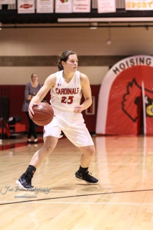 Hoisington Lady Cardinal #25 Maleigha Schmidt looks to drive to the lane in the third quarter. The Plainville Lady Cardinals defeated the Hoisington Lady Cardinals by a score of 49 to 35 at the Hoisington Activity Center in Hoisington, Kansas on February 5, 2019. (Photo: Joey Bahr, www.joeybahr.com)