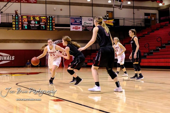 Hoisington Lady Cardinal #25 Maleigha Schmidt drives towards the basket in the fourth quarter. The Plainville Lady Cardinals defeated the Hoisington Lady Cardinals by a score of 49 to 35 at the Hoisington Activity Center in Hoisington, Kansas on February 5, 2019. (Photo: Joey Bahr, www.joeybahr.com)