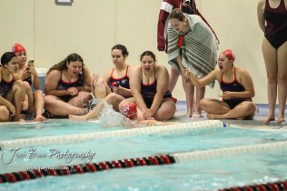 Teammates cheer on Laura Mier of Dodge City in the 200 yard Freestyle. The Great Bend Girls Swimming Invitational was held at the Kirkman Activity Center on the campus of Barton Community College in Great Bend on 4 20190426, 2019. (Photo: Joey Bahr, www.joeybahr.com)