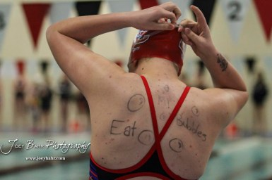 Paige Mink of Dodge City shows off her message to her fellow competitors. The Great Bend Girls Swimming Invitational was held at the Kirkman Activity Center on the campus of Barton Community College in Great Bend on 4 20190426, 2019. (Photo: Joey Bahr, www.joeybahr.com)