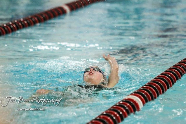 Jerzie Sierminski of Salina South competes in the 100 yard Backstroke. The Great Bend Girls Swimming Invitational was held at the Kirkman Activity Center on the campus of Barton Community College in Great Bend on 4 20190426, 2019. (Photo: Joey Bahr, www.joeybahr.com)