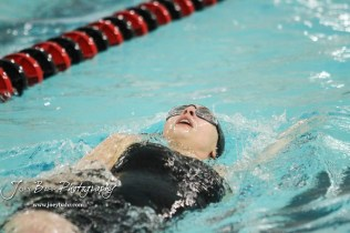 Katherine Snapp of Great Bend swims in the 100 yard Backstroke. The Great Bend Girls Swimming Invitational was held at the Kirkman Activity Center on the campus of Barton Community College in Great Bend on 4 20190426, 2019. (Photo: Joey Bahr, www.joeybahr.com)